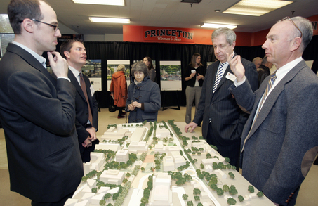 BBB architects speak with Princeton University officials over a scale-model of the campus