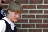 Police lead suspected shooter Dylann Roof into the courthouse in Shelby, North Carolina, June 18, 2015.  Roof, a 21-year-old with a criminal record, is accused of killing nine people at a Bible-study meeting in a historic African-American church in Charleston, South Carolina, in an attack U.S. officials are investigating as a hate crime.  REUTERS/Jason Miczek - RTX1H5ZR