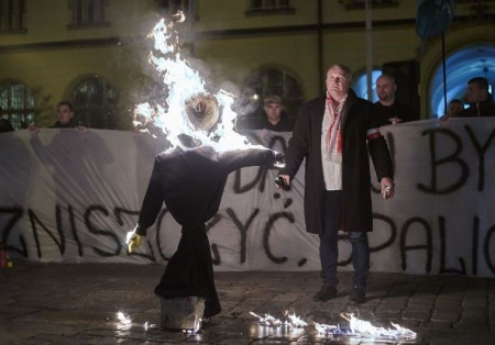 Demonstrators burn an orthodox Jew in effigy during an anti-migrant rally in Poland.